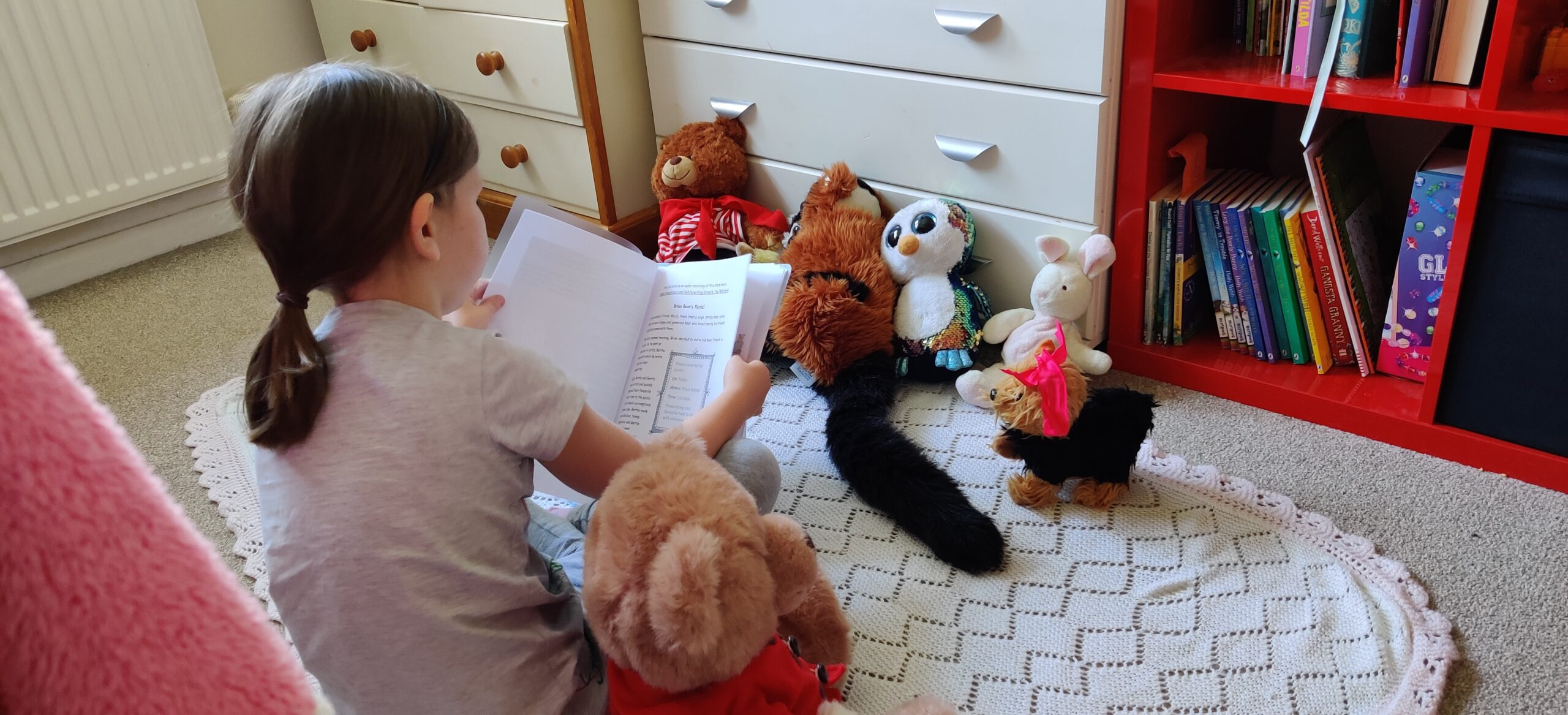 RN (Y1) reading to teddies
